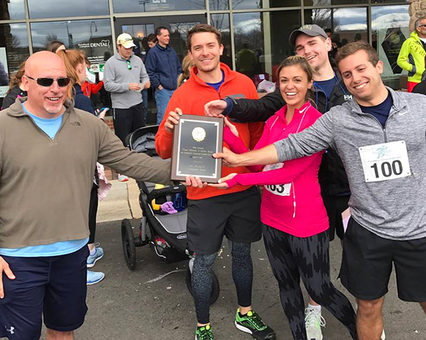Photo of winners at charity run.